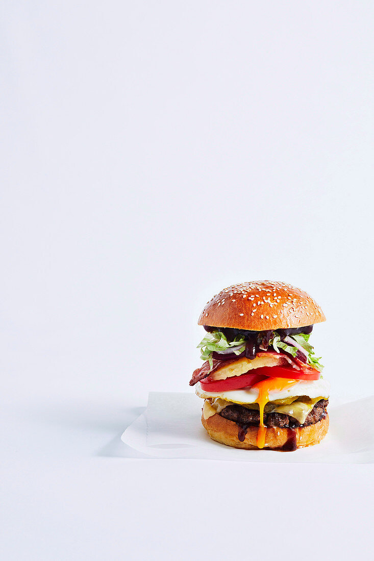 Australian burger with fried egg, barbecue sauce and a beef patty
