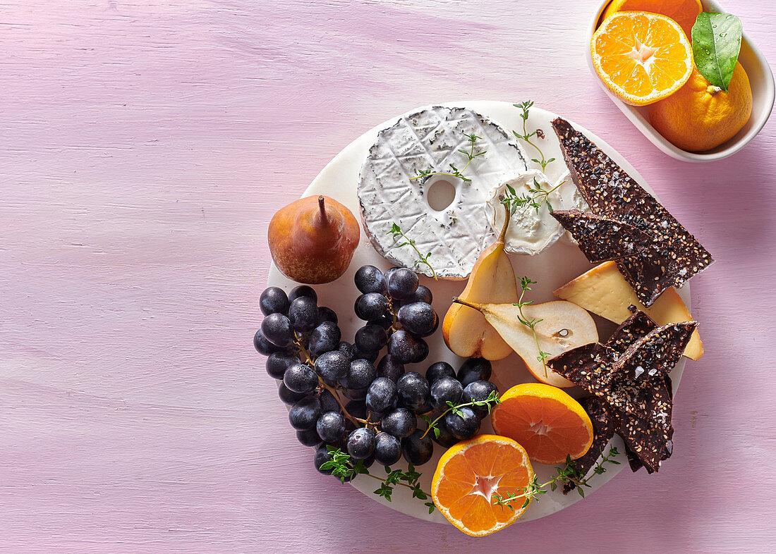 Winter cheeseboard with sesame-cocoa bark