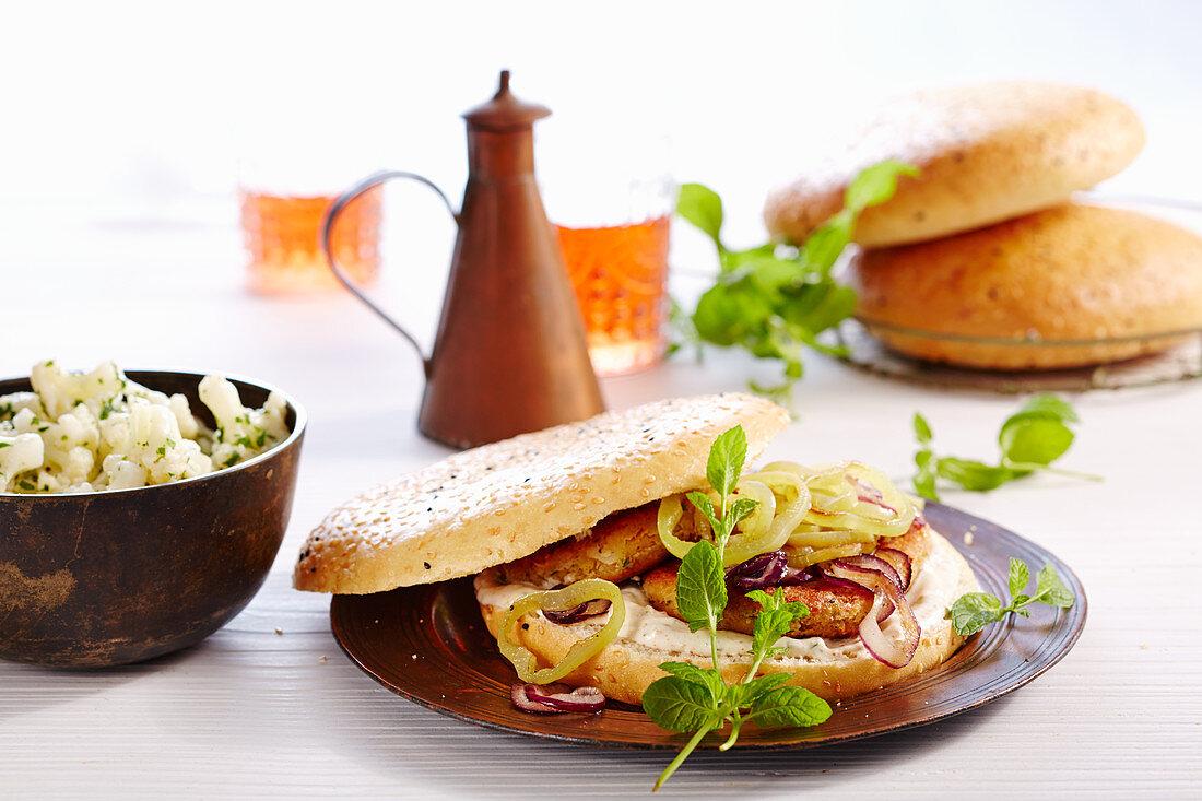 Vegetarian chickpea burger with cauliflower salad and yoghurt sauce (Turkey)