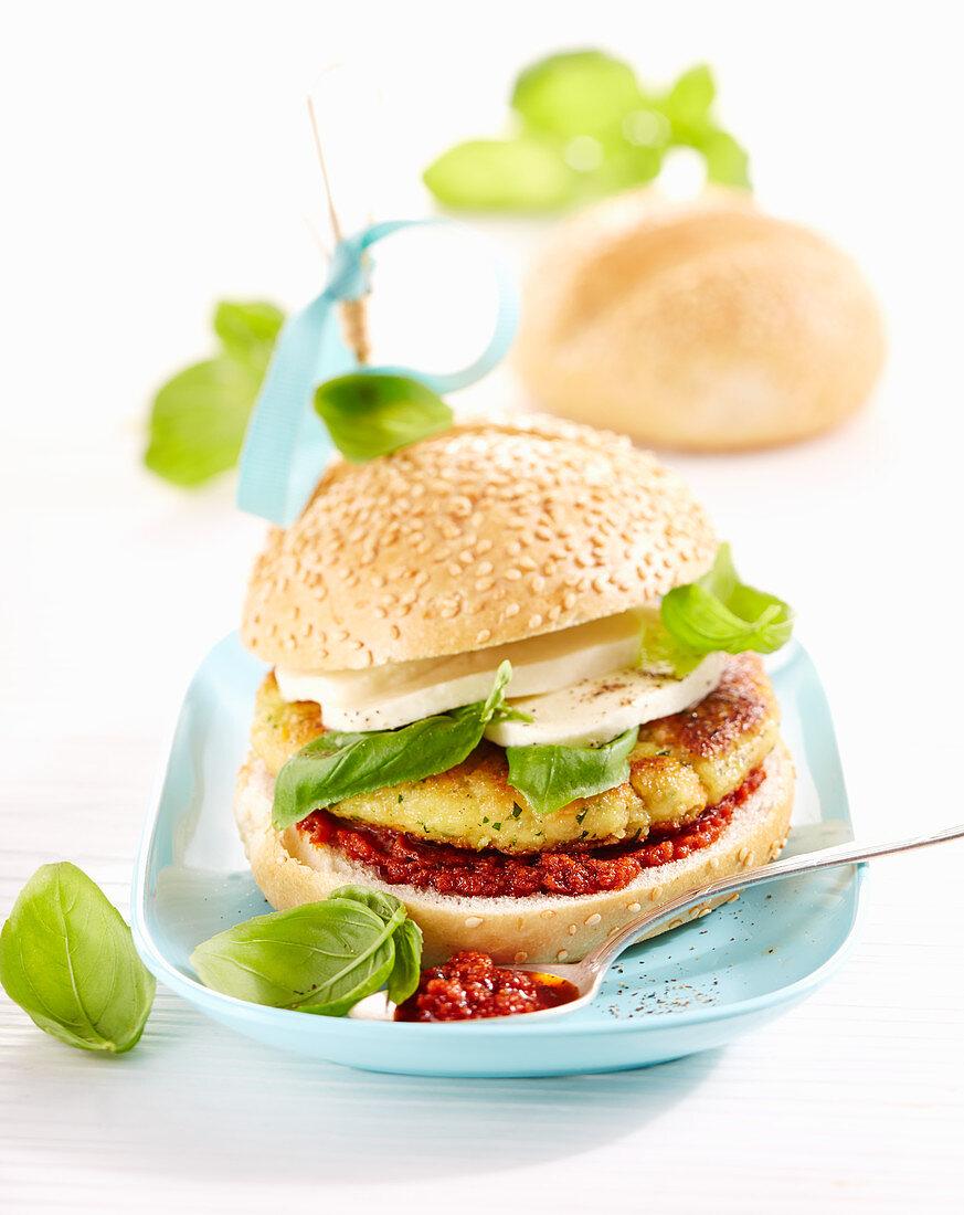 A vegetable burger with pesto rosso, mozzarella and basil
