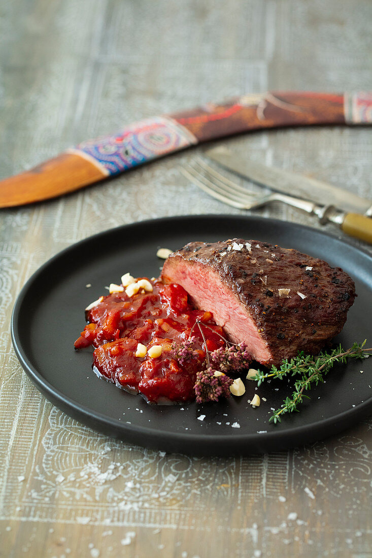 Emu steak with tomato and bacon chutney and peanuts (Australia)
