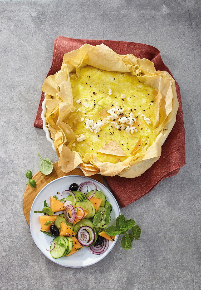 Filo pastry quiche with feta cheese served with a cucumber and melon salad