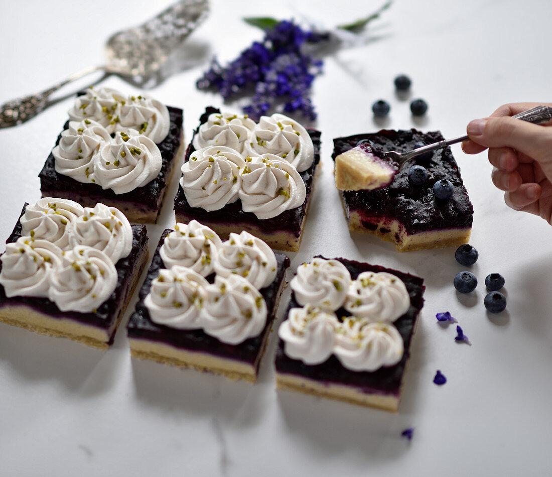 Vegan blueberry and quark semolina cake with cream and chopped pistachios