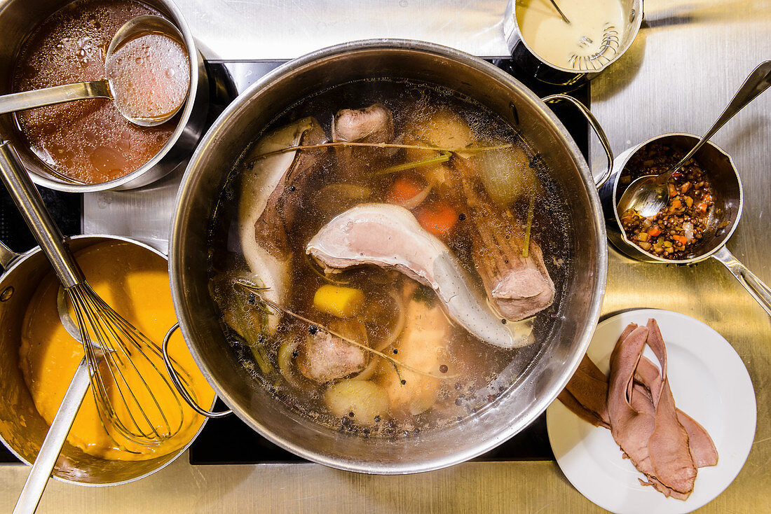 Beef broth with meat and vegetables in a saucepan