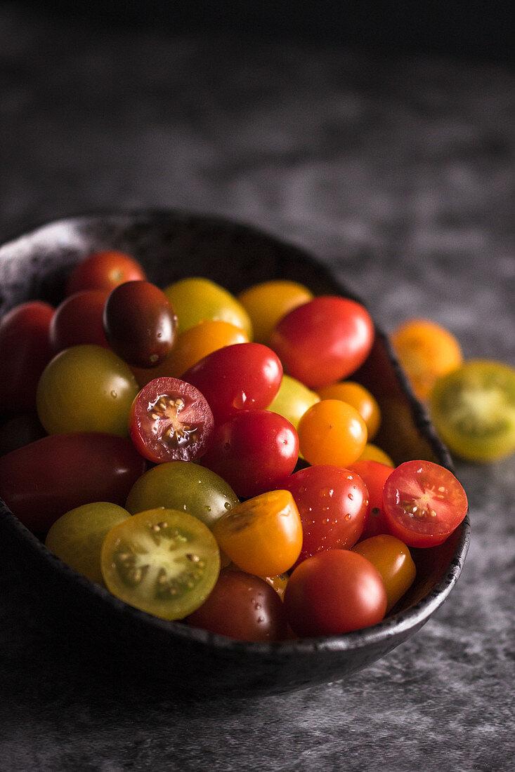 Cherries tomatoes in a black bowl