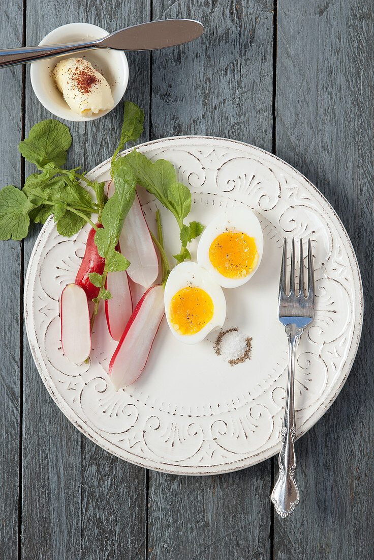 Soft boiled egg with radish salt and pepper, with butter