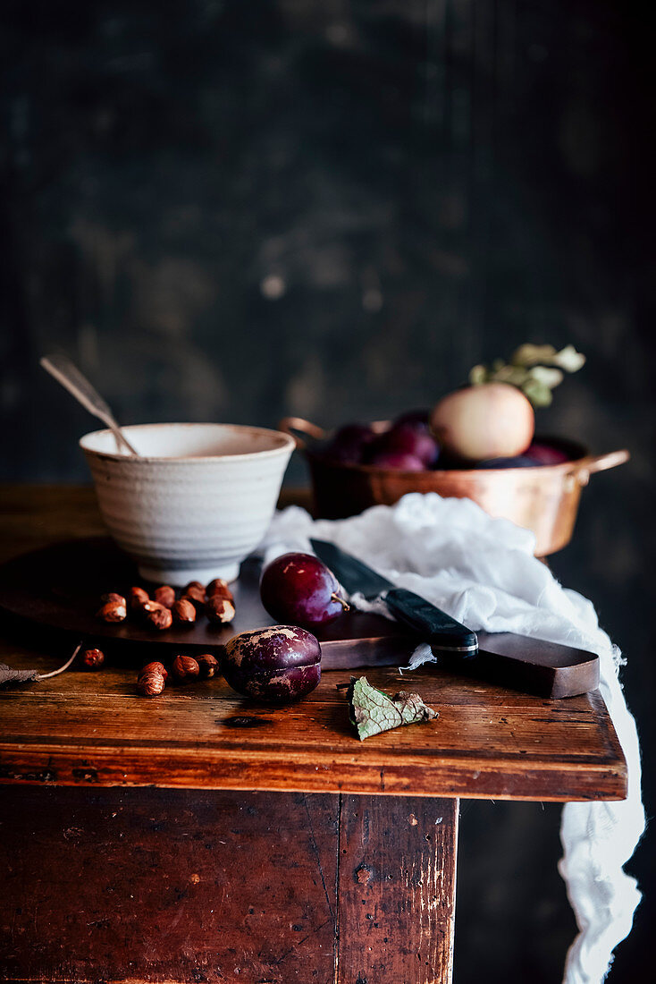 Still Life with plum and nuts