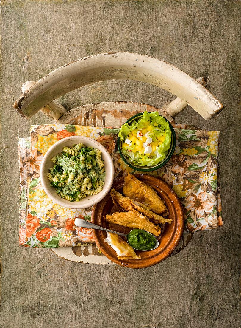 Mango salad, fusilli in romaine lettuce cream, fish fillets with green sauce