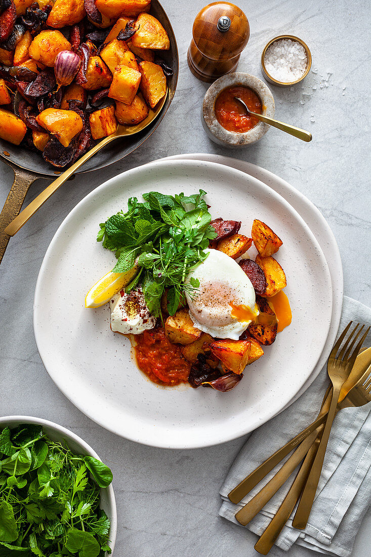 Agria and Chorizo Hash with Poached Egg, smokey tomato sauce and labne