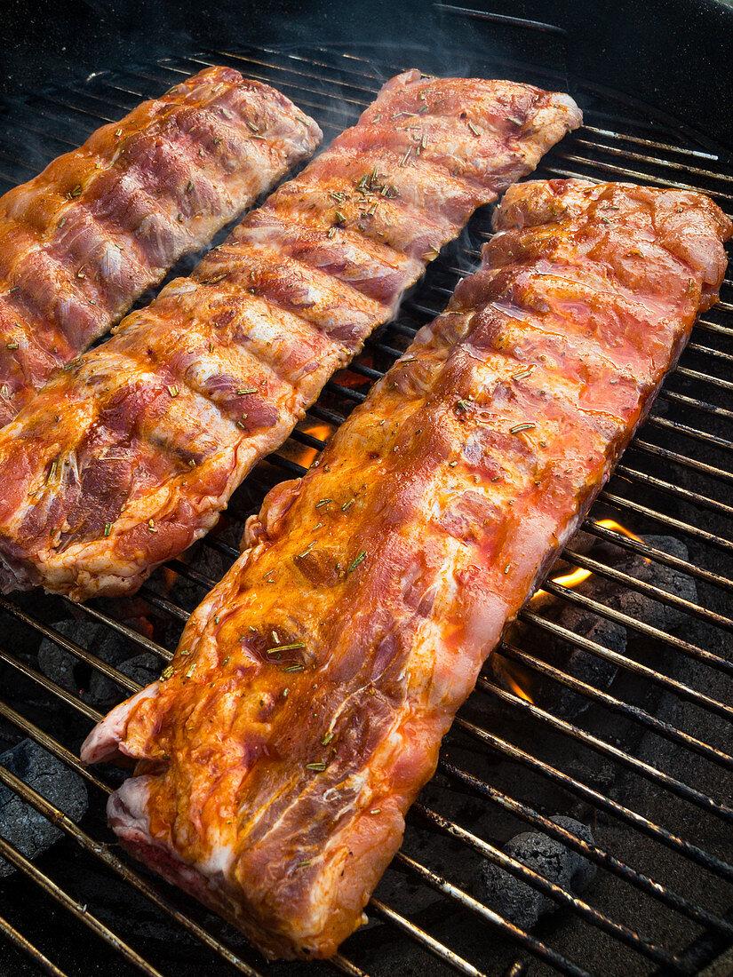 Marinated Duroc pork ribs on a grill