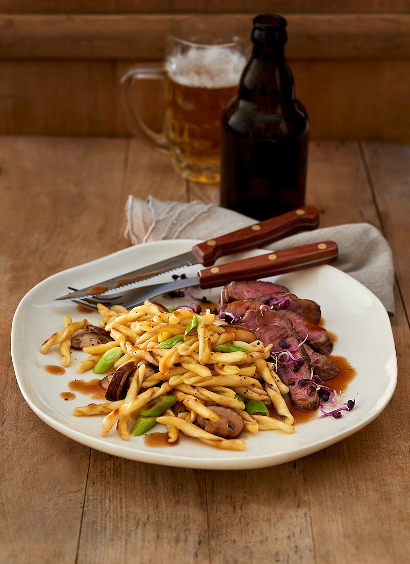 Beer steaks with fricelli and mushroom sauce