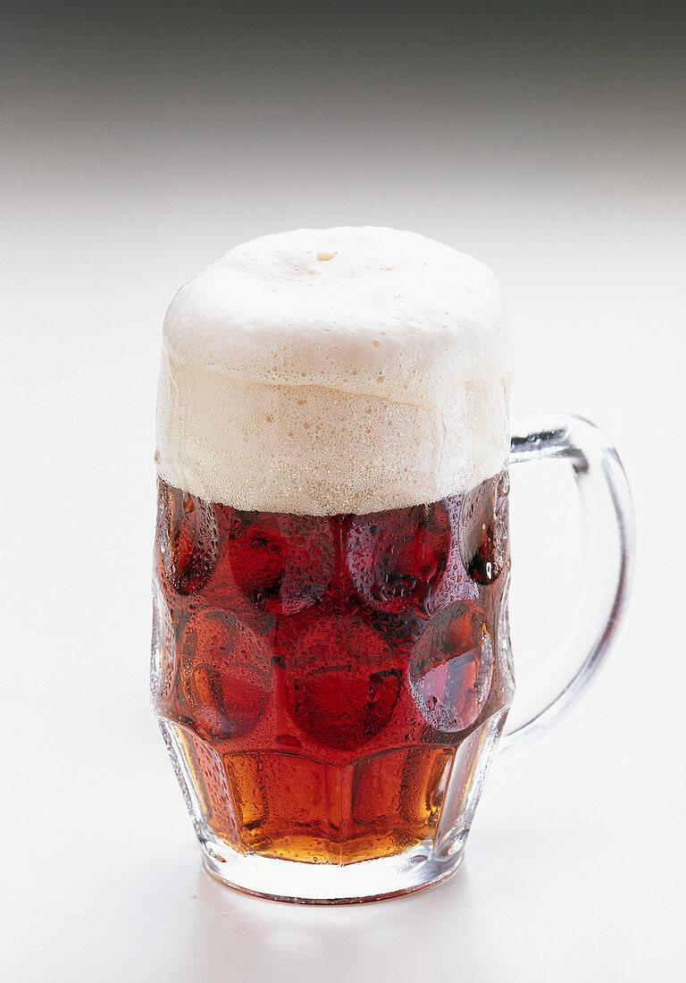 Dark strong beer in a glass jug (bock beer)