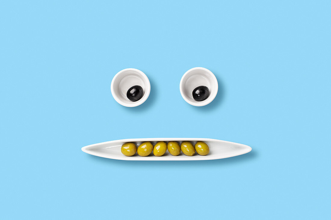 Olives on tray forming a face