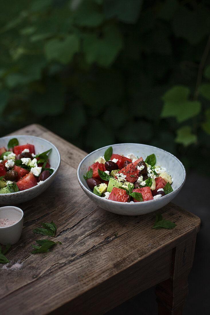 Water melon, avocado, kalamata olive and goat cheeese (or feta) salad