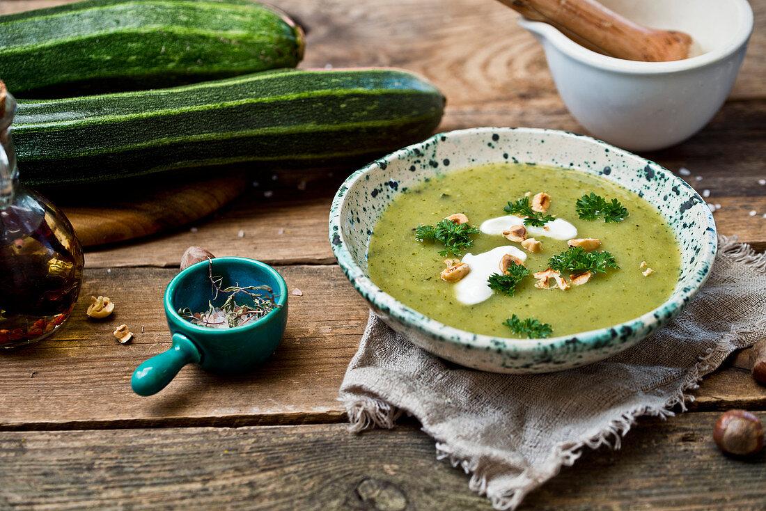 Zucchini cream soup with peanuts
