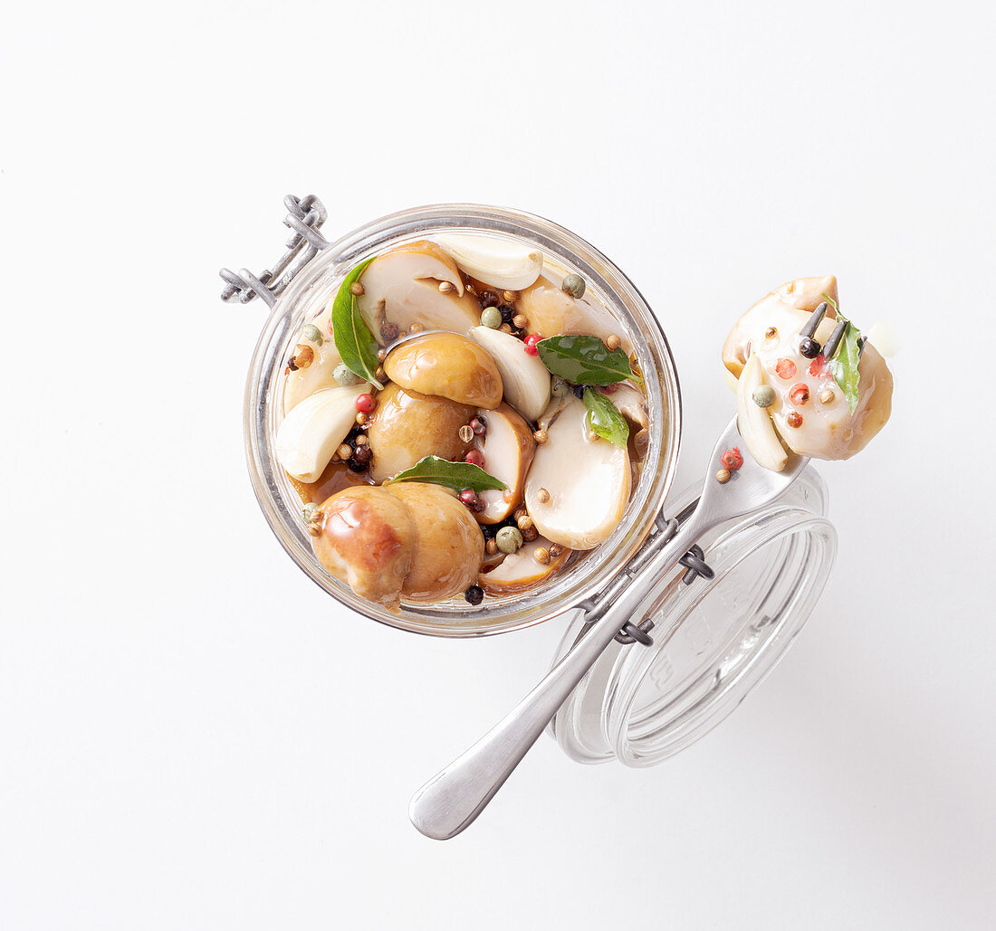 Boletus mushrooms in oil with various spices and herbs