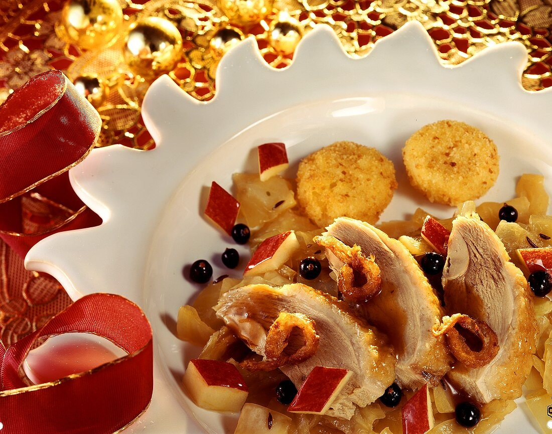 Duck breast on warm fruit salad with potato cakes