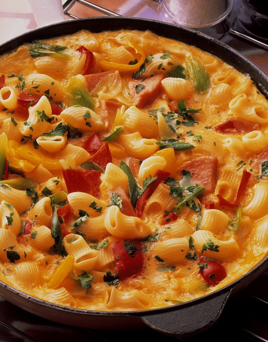 Tortilla with macaroni, vegetables, sausage & parsley