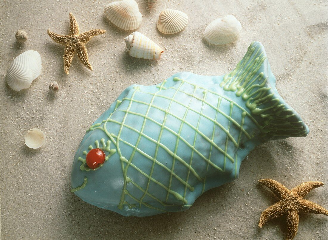 Fish-shaped cake with prunes and blue icing