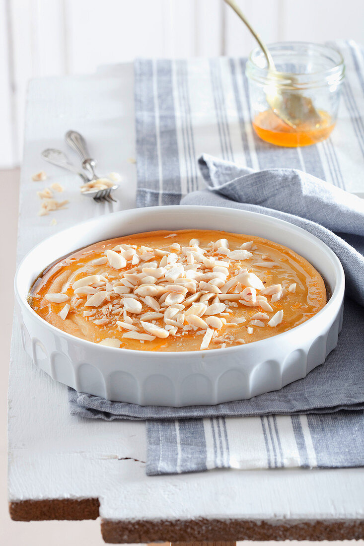 Baked ricotta cream with orange syrup and almonds