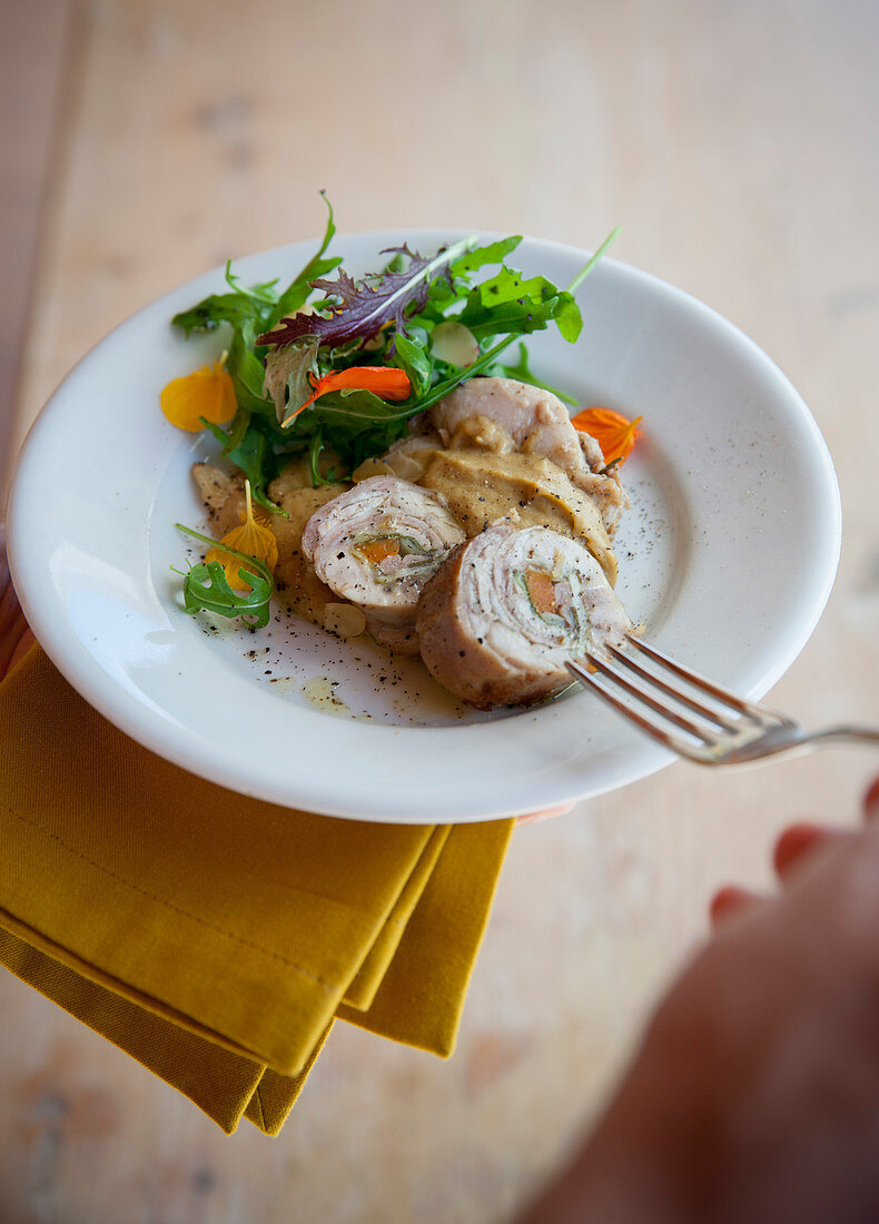 Rabbit roulade with a tuna sauce and a side salad