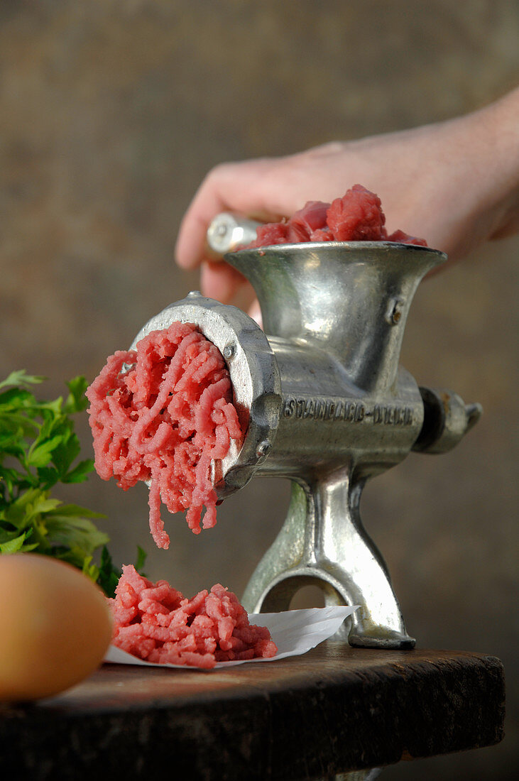 Minced meat in mincer
