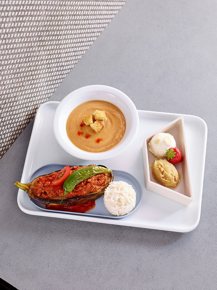 Red lentil soup, aubergine filled with minced meat and rice and an ice cream dessert