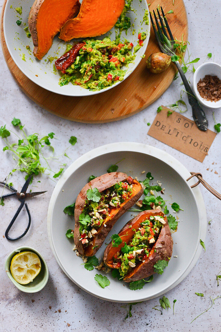 Baked sweet potatoes whole with avocado paste