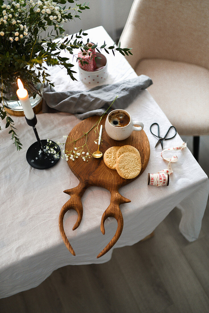 Christmas holiday table coffee mug candle holder almond cookies wooden board