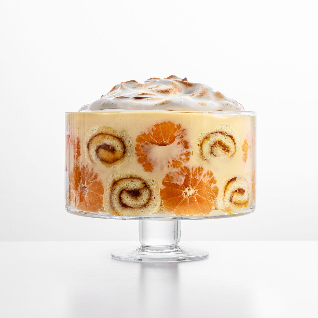 Sponge and clementine trifle with lime cream and a meringue topping