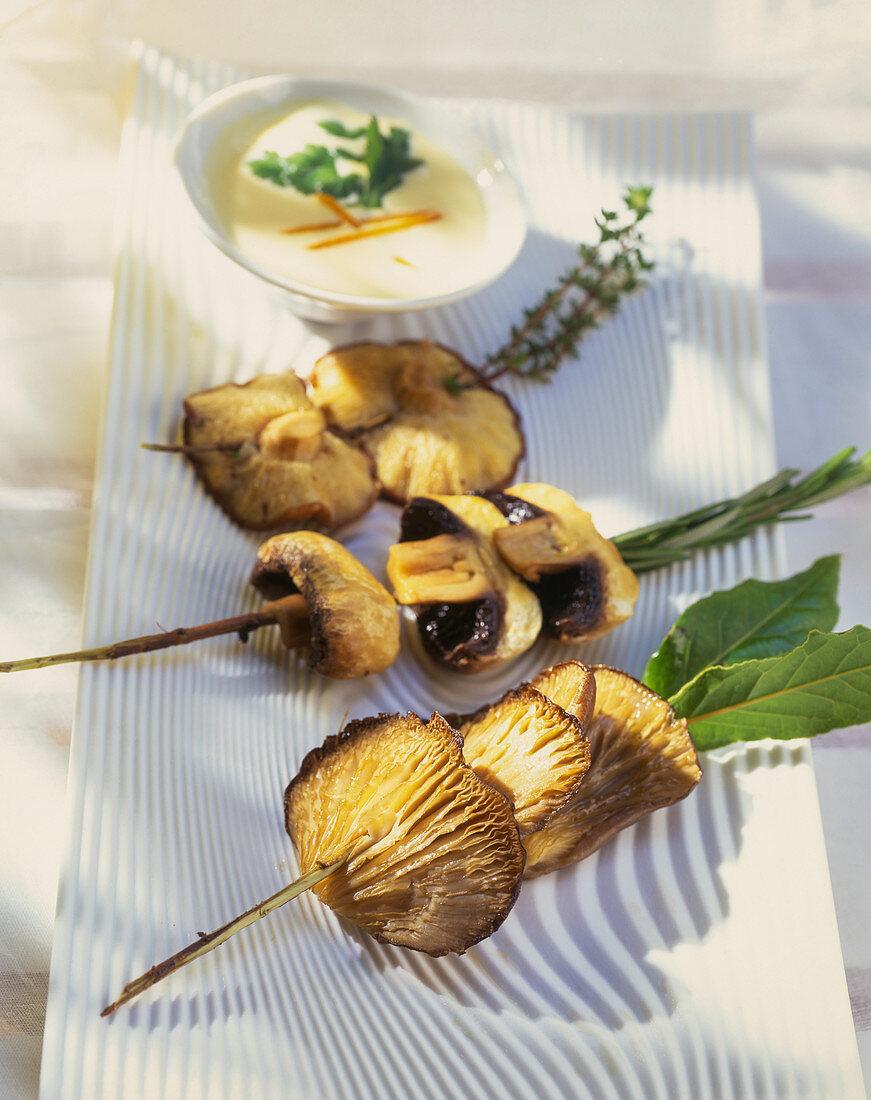 Mushroom skewers with a dip