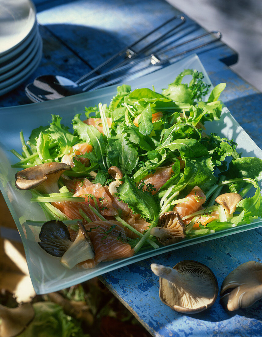 A mixed leaf salad with fish and mushrooms