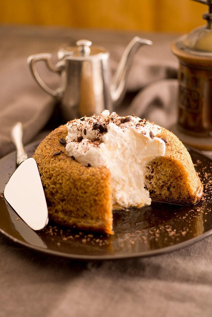Coffee and vanilla savarin with cream and chocolate