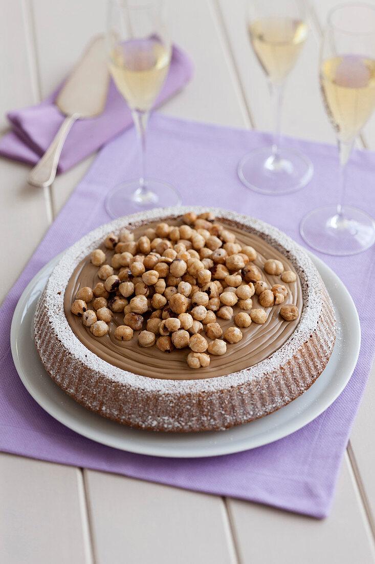 Ricotta cake with hazelnut cream and roasted, salted hazelnuts