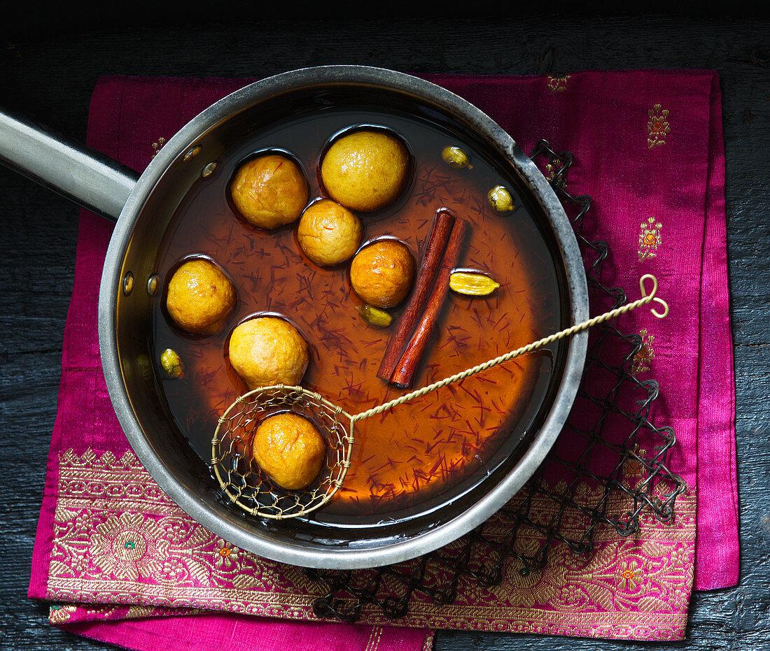 Gulab Jamun (sweet fried milkballs in sugar syrup, India)