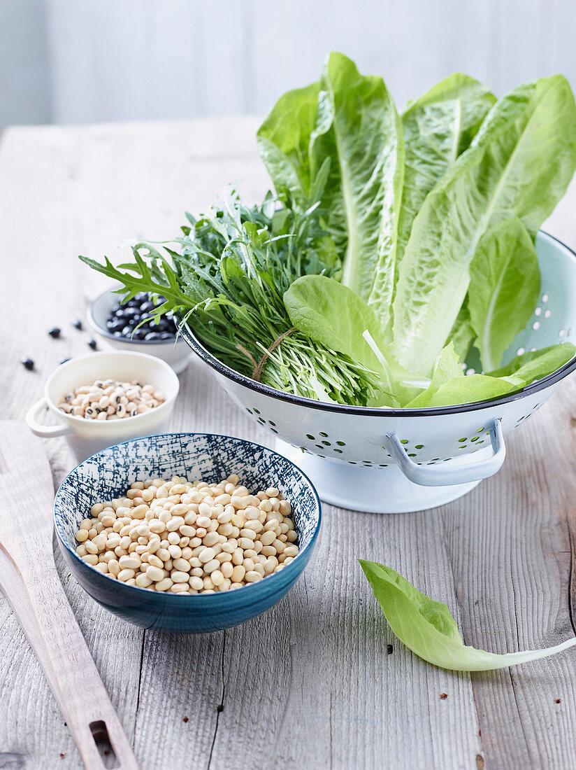 An arrangement of legumes and lettuce