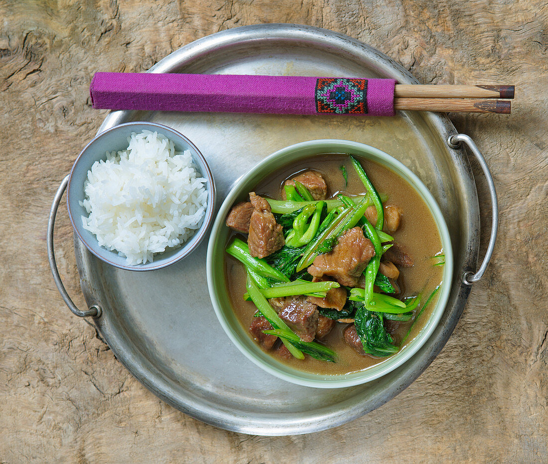 Fried pork with Chinese broccoli and rice (Asia)