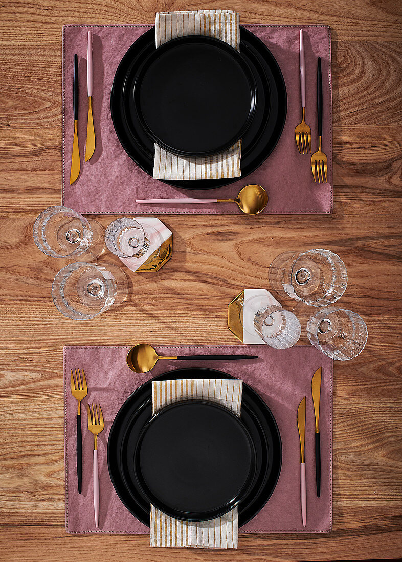 Elegantly laid table with gold cutlery