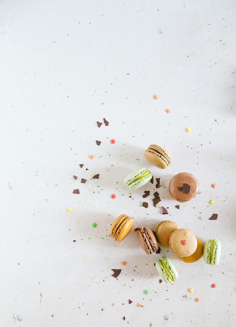 Colorful macarones with chocolate chips and sugar stars