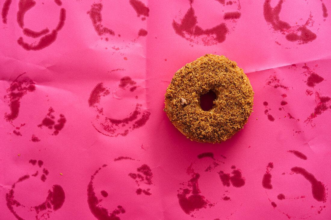 Doughnut on pink background
