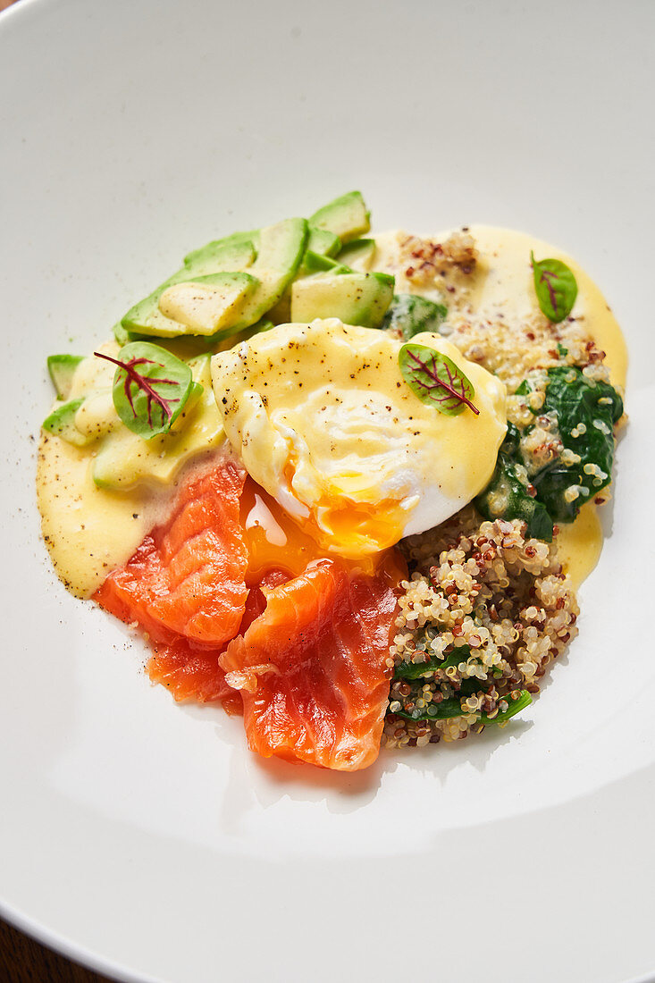 Tasty snack with poached egg and fish
