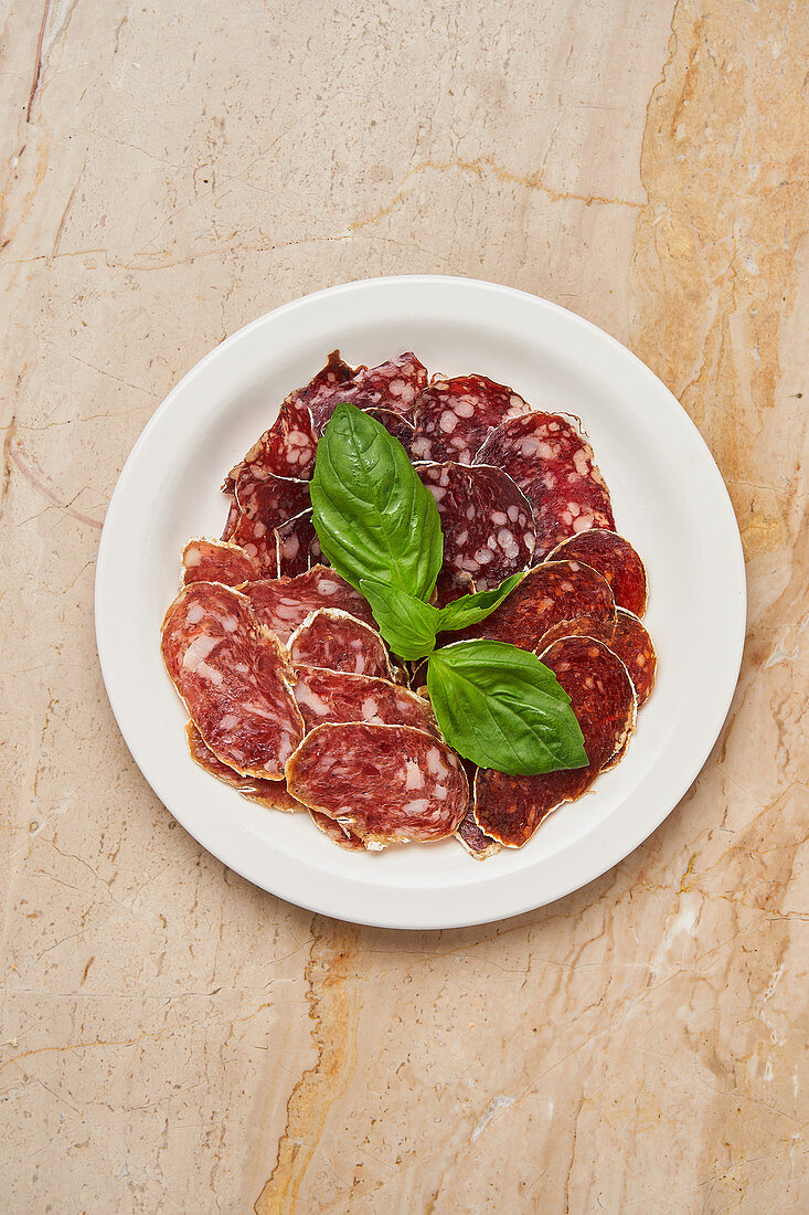 Pieces of dried meat with basil