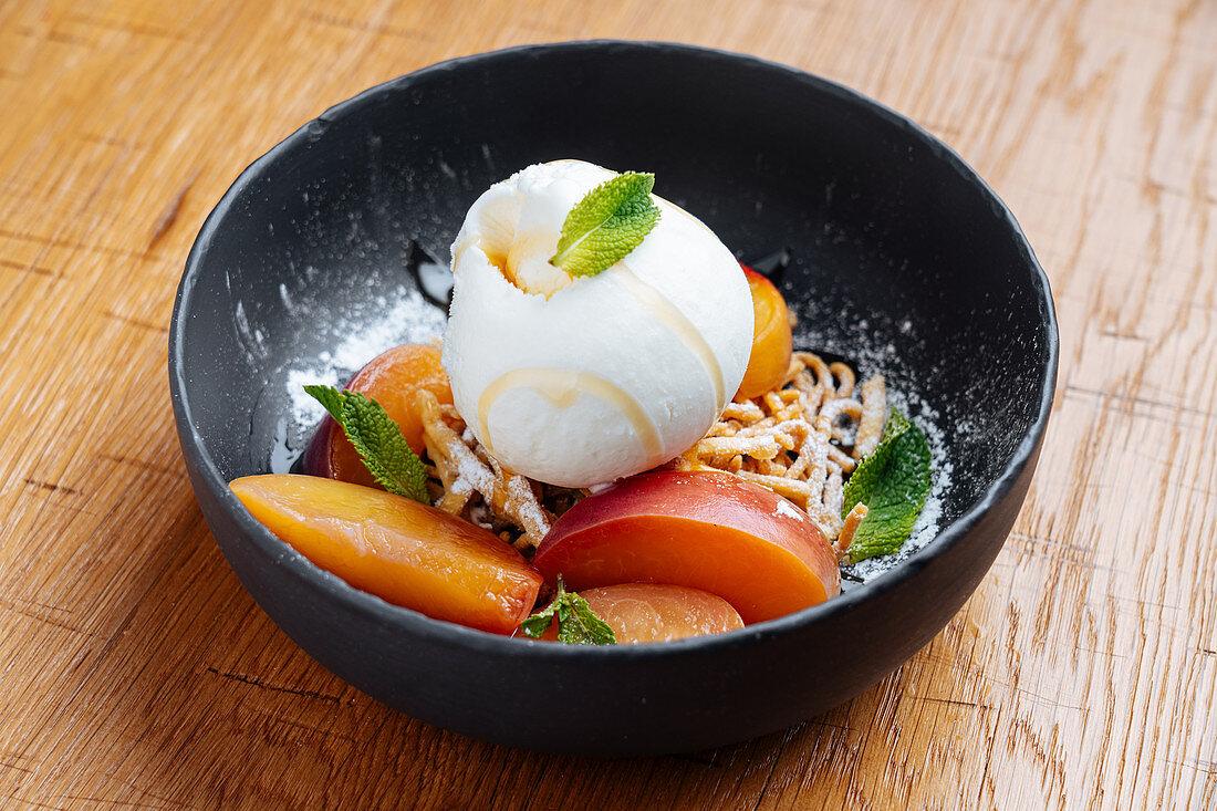 High cuisine modern dessert with ice cream and fruit