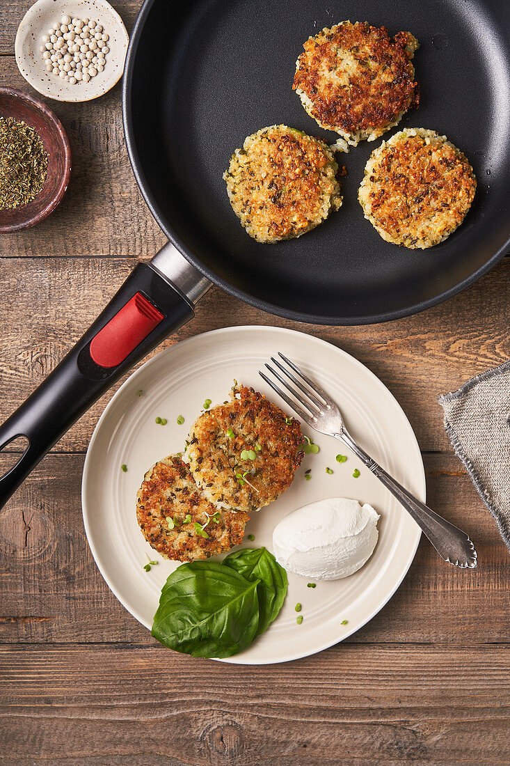 Tasty cutlets in pan and plate