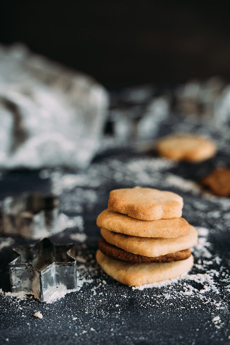 Delicious baked biscuits on plate in kitchen