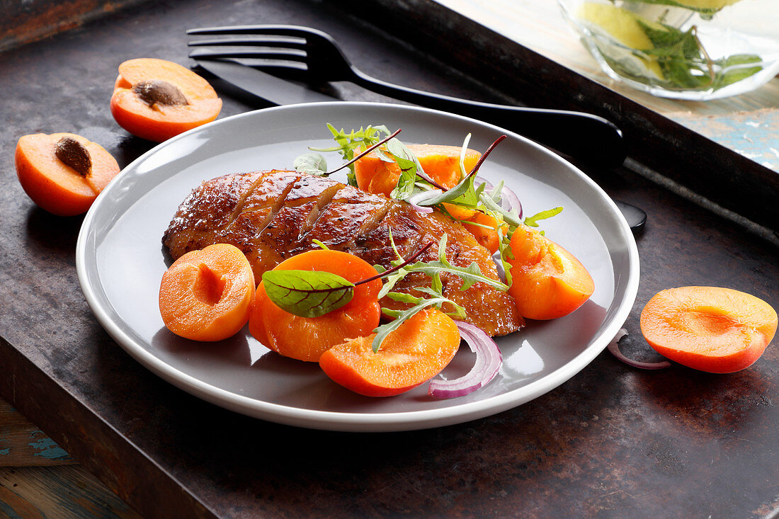 Duck breast roasted in honey marinade with apricots