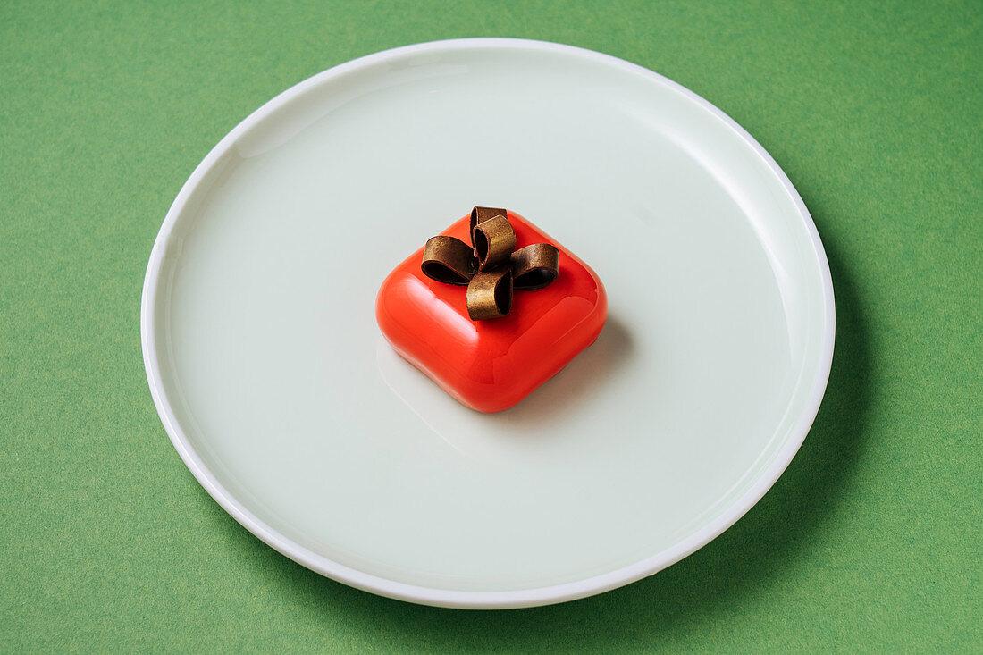 Gift shaped dessert on plate