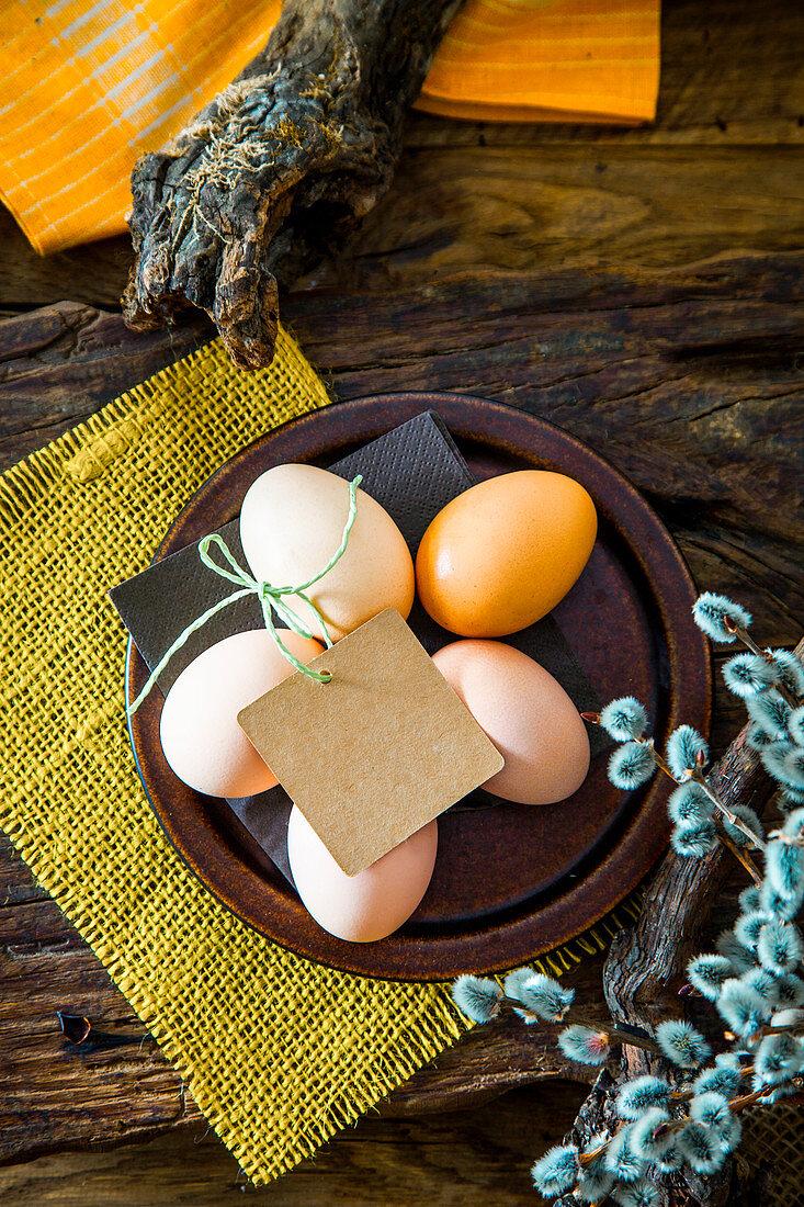 Easter table setting. Fresh eggs on plate