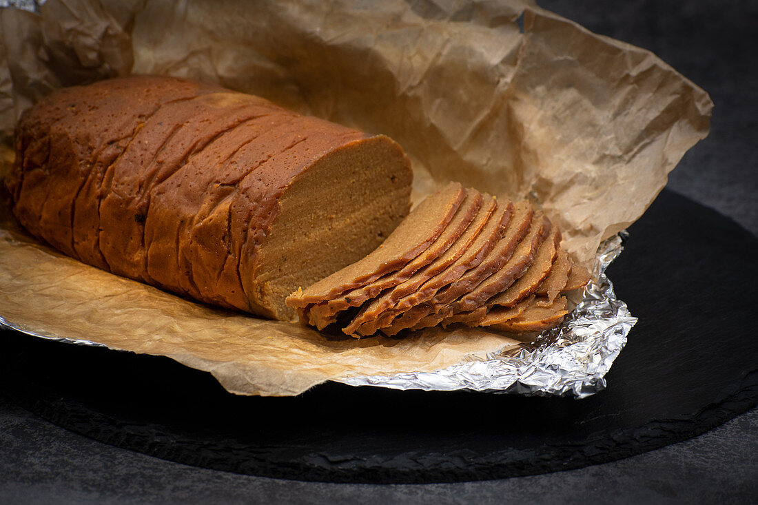 Vegan seitan ham prepared with wheat gluten and chickpea flour, soy sayce and spices