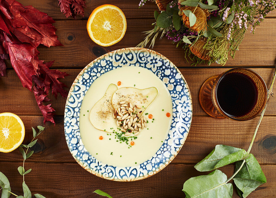 Citruses and wine cream soup amidst floral twigs